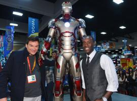 Iron Man 3 director Shane Black and star Don Cheadle pose with the new Iron Man armor at the Marvel Booth at SDCC 2012
