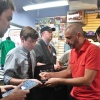 Axel Alonso signing autographs at Midtown Comics' Meet the Publishers