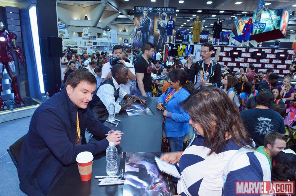 Iron Man 3 director Shane Black and star Don Cheadle signing at the Marvel Booth at SDCC 2012