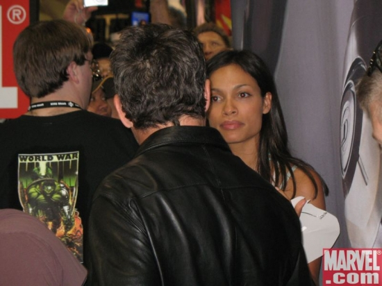 Rosario Dawson stops by the Marvel booth to say hello to Robert Downey Jr.