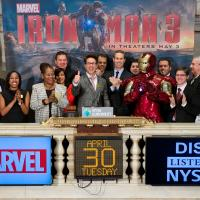 Robert Downey Jr. ringing the opening bell at the NYSE, along with Iron Man and the Marvel staff