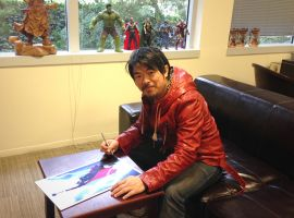Artist Charlie Wen signing the limited edition metal variant print of Marvel's Thor: The Dark World