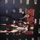 Robert Downey Jr stands with the Mark 42 armor at the chinese premier of Marvel's Iron Man 3