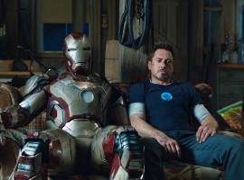 Tony Stark (Robery Downey, Jr.) and the damaged Mark 42 from Marvel's Iron Man 3