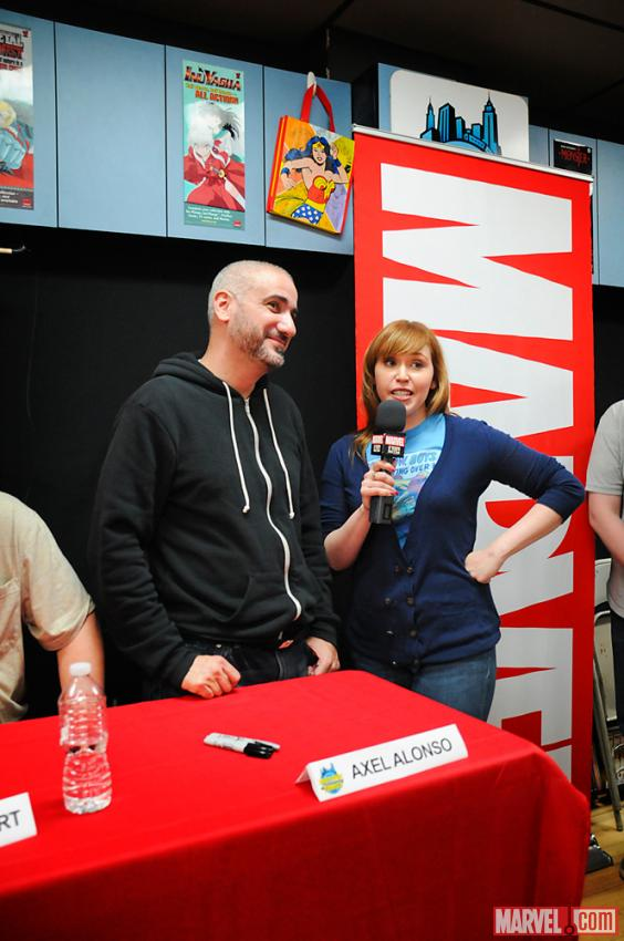 The Watcher's Lorraine Cink and Axel Alonso at Avengers Vs X-Men Release Party at Midtown Comics