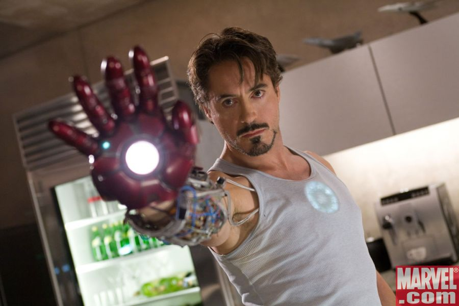 Downey Jr. as Stark, wielding Iron Man's gauntlet