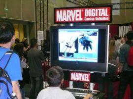 Fans enjoying Marvel Digital Comics Unlimited at the Marvel booth