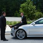 Happy Hogan (Jon Favreau) questions Savin (James Badge Dale) on the Audi S7 Sportback in Marvel's Iron Man 3