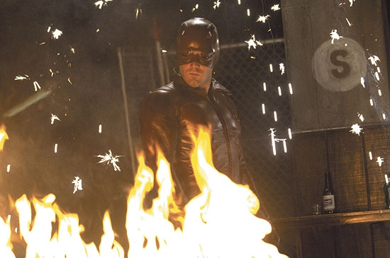Daredevil standing behind fire