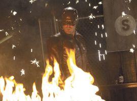 Daredevil standing behind fire
