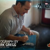 Clark Gregg signing an Agent Coulson figure's package for Hot Toys