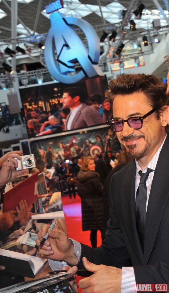 "Robert Downey, Jr. signing autographs at the London premiere of ""Marvel's The Avengers"""