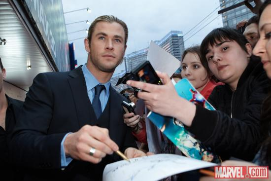 Chris Hemsworth signs autographs at the Moscow premiere of Marvel's The Avengers