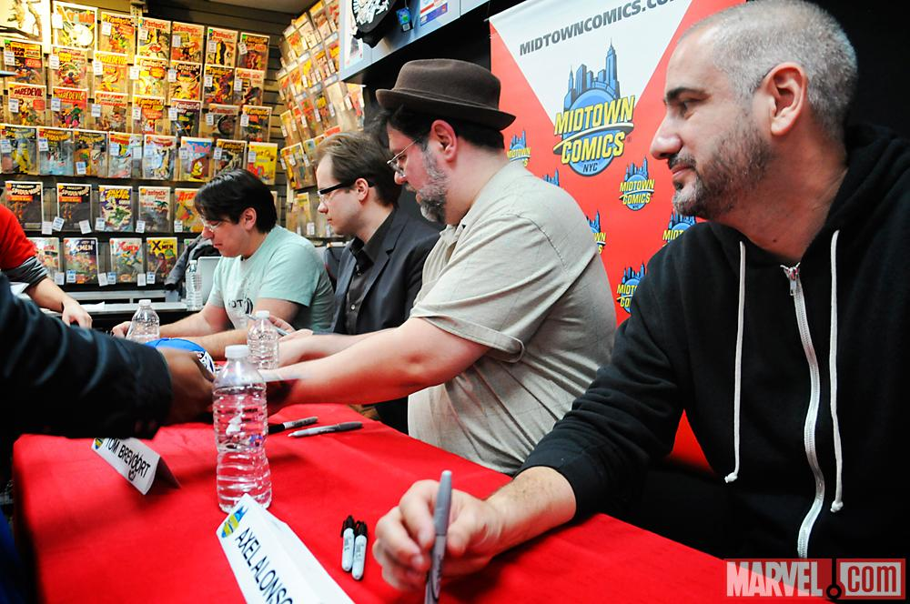 Avengers Vs X-Men Creators at Signing Table at Release Party at Midtown Comics