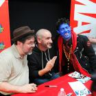 Tom Brevoort, Axel Alonso and Nightcrawler Cosplayer at Avengers Vs X-Men Release Party at Midtown Comics