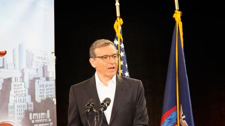Disney CEO Bob Iger at the podium for a special press conference to announce the filming of Marvel's Netflix series in New York