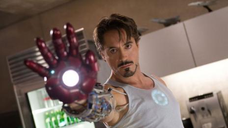 Downey Jr. as Stark, wielding Iron Man's gauntlet