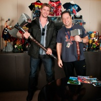 Chris Hemsworth and Joe Quesada wield Thor's hammers